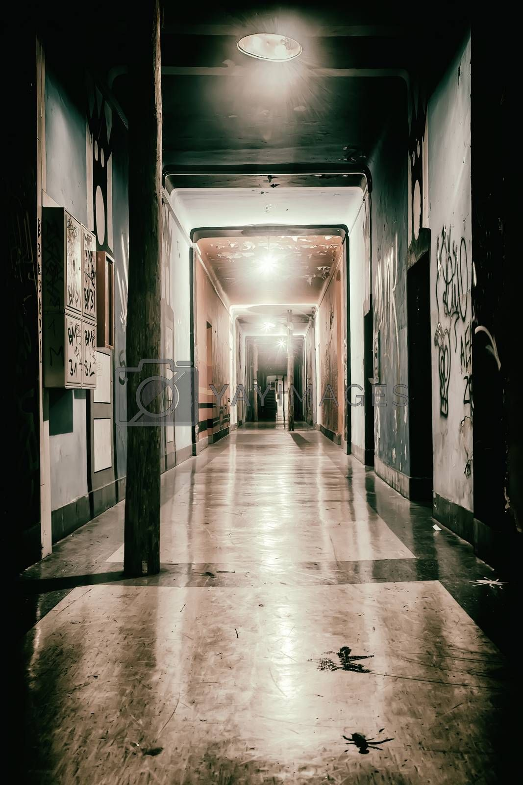 illuminated and empty hallway of the former barracks