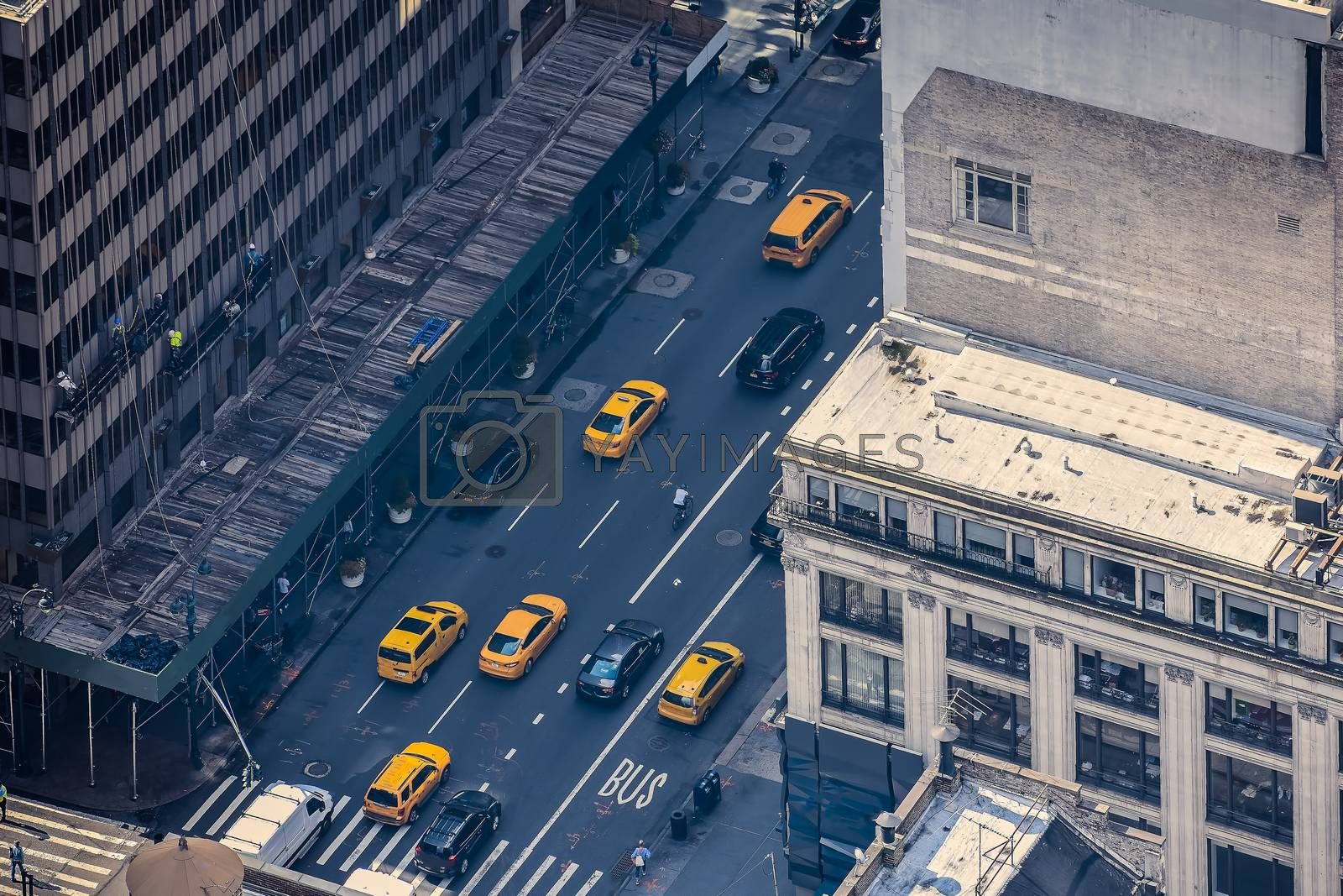 Airstrip of New York City, with buildings and streets filled with the famous yellow taxis during the day. Concept of travel and transport. NYC, USA.