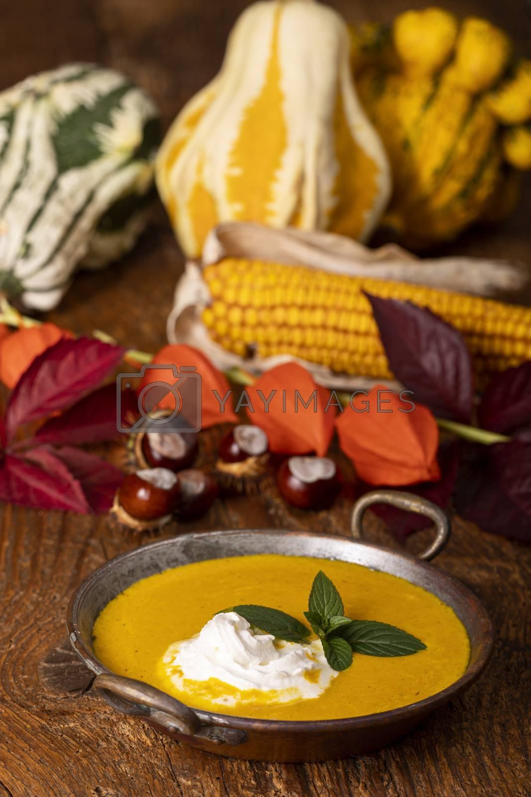 pumpkin soup on dark wood