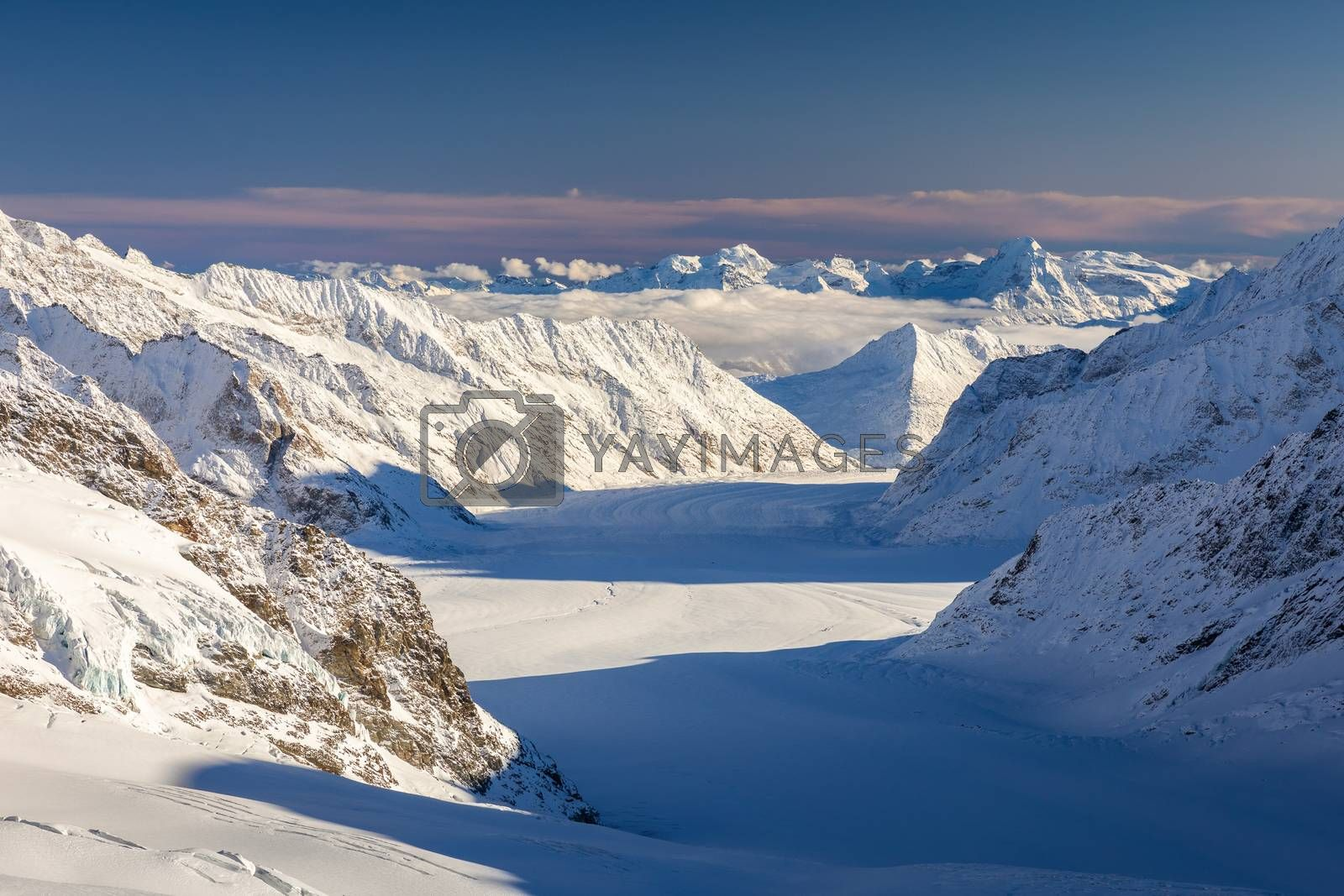 Aerial of snowcapped mountain range of Jungfrau in winter before sunset, view from Jungfraujoch in middle of Jungfrau and Monch, Interlaken, Switzerland.