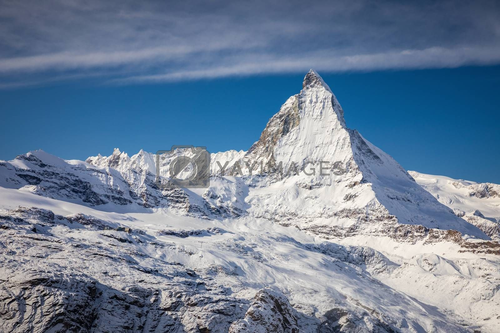 Aerial of Matterhorn summit looking from Gornergrat mountain, most area covered by snow in early winter in Zermatt, Switzerland.