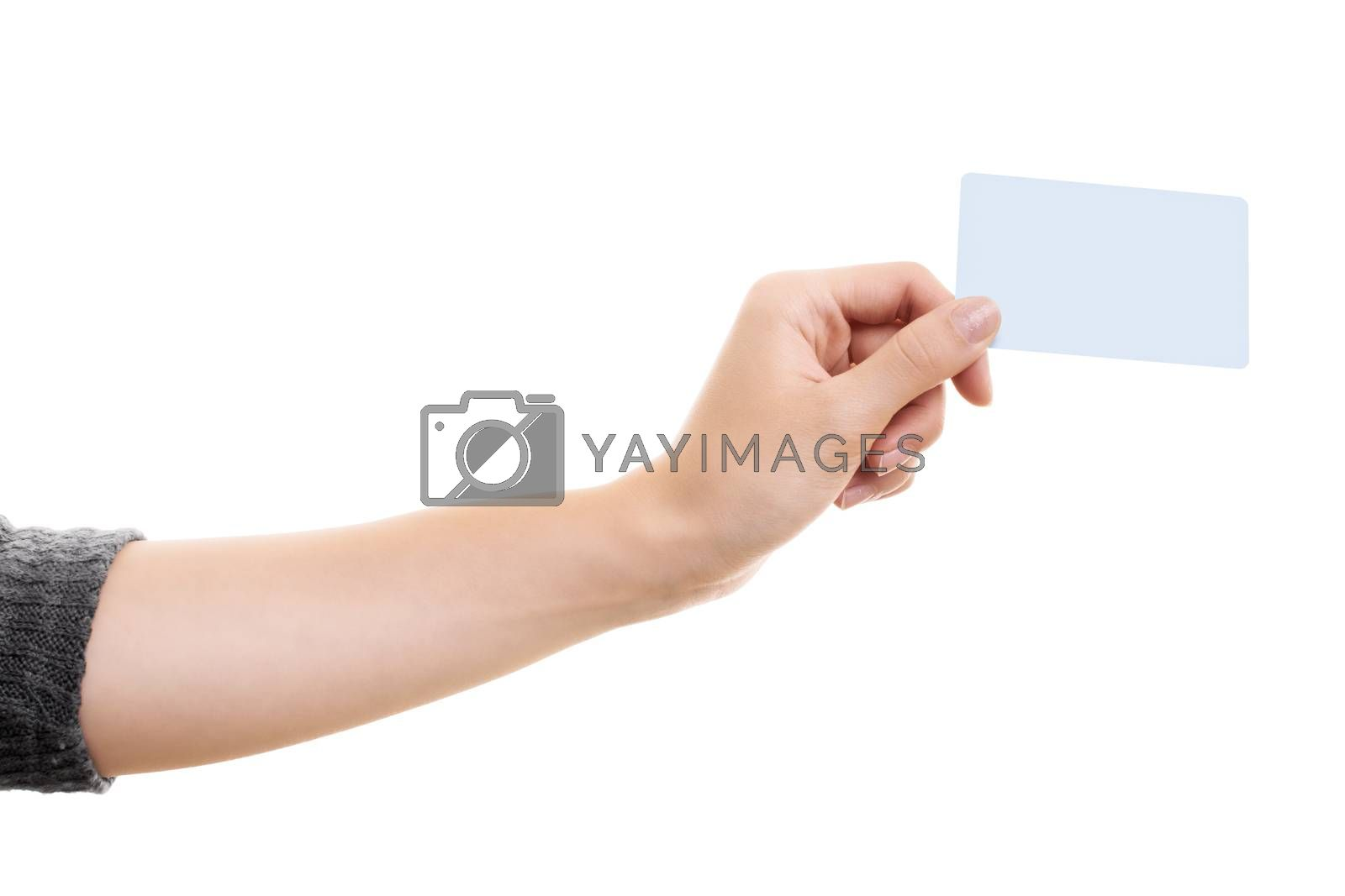 Female hand holding a blank white card mock up, isolated on white background. Business communication and advertising concept. Hand holding a plain call-card mock up template.