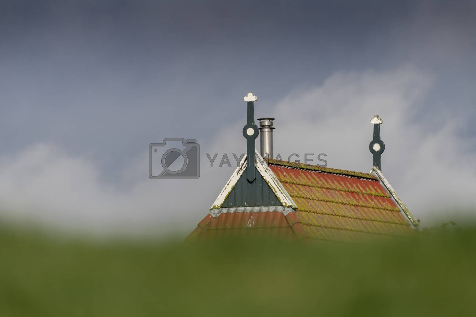 Gable of a farm behind a dike   by Tofotografie