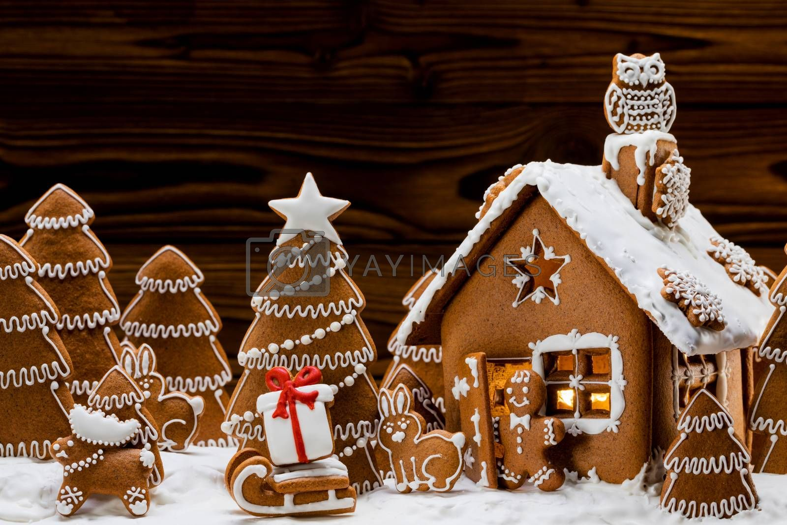 Gingerbread house christmas fir trees and gift cookies winter holiday celebration concept