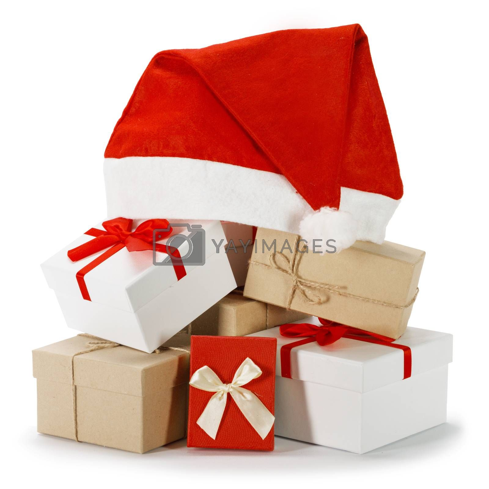Christmas red and white gift boxes heap with Santa hat on top isolated on white background