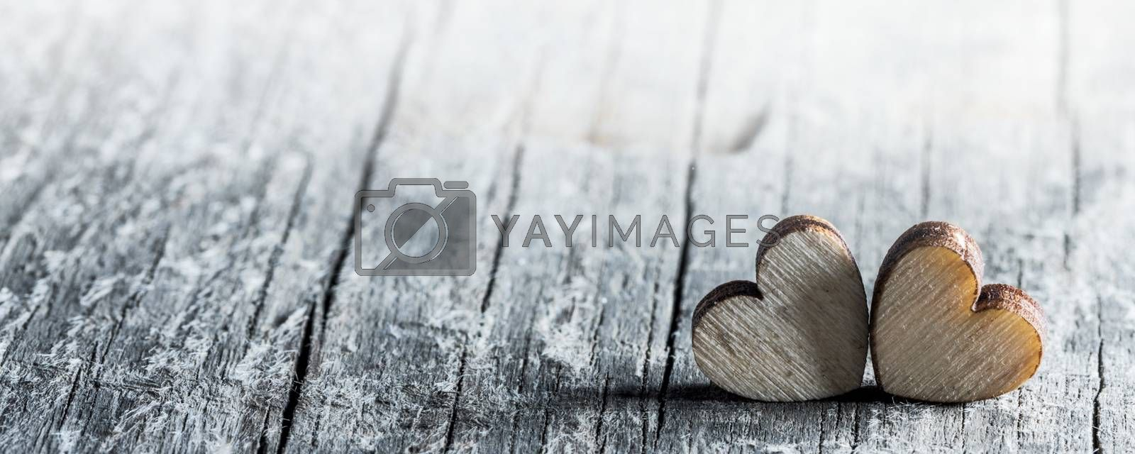 Two handmade wooden carved hearts on wood background couple relationship Valentine day concept
