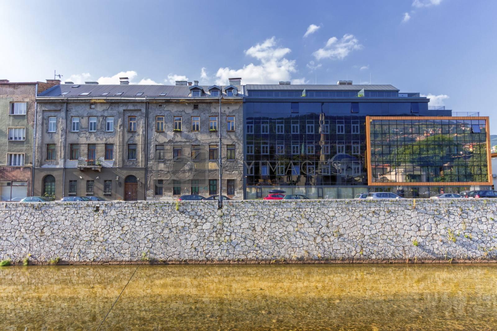 Old and modern buildings in Sarajevo by day and Milyacka River, Bosnia-Herzergovina