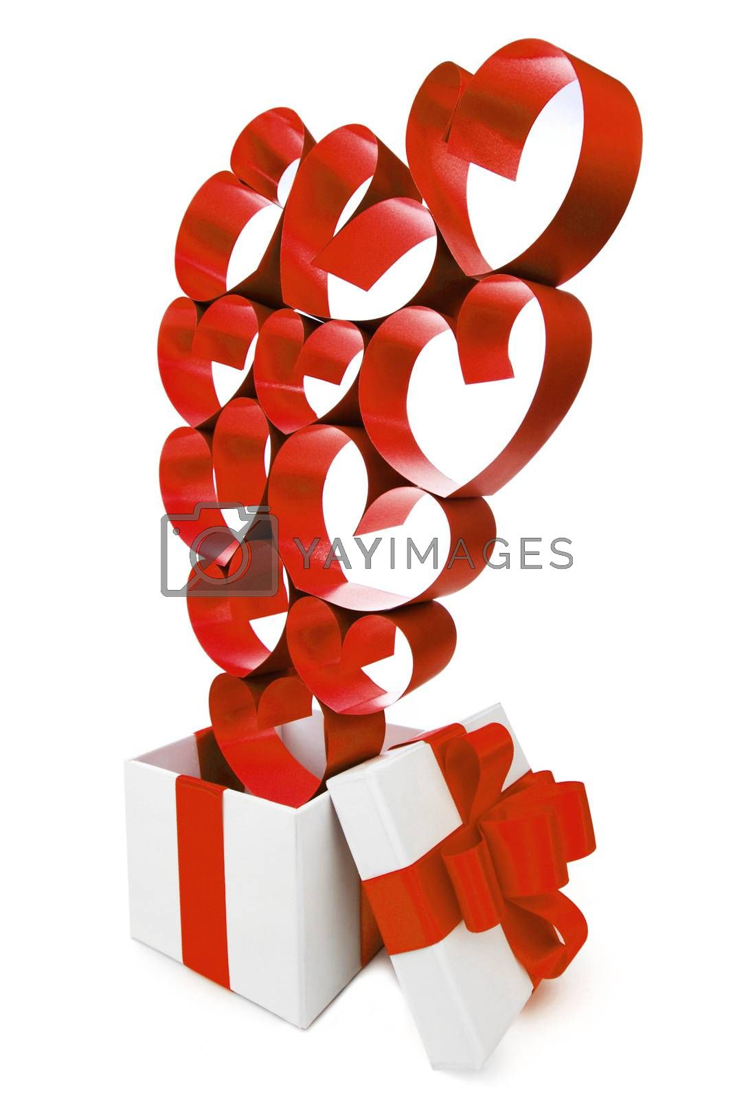 Gift in white box with pink ribbons and hearts isolated on white background