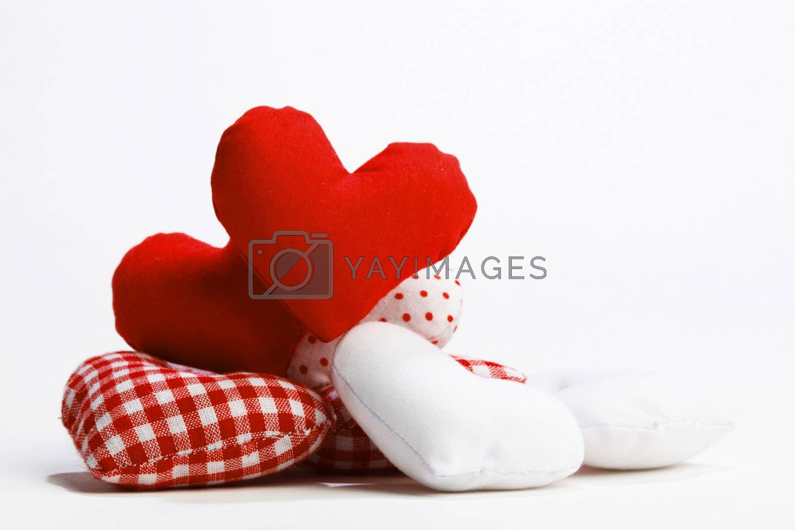Textile red hearts isolated on white background