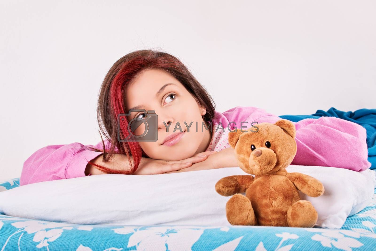 Young girl in bed with her teddy bear by Mendelex