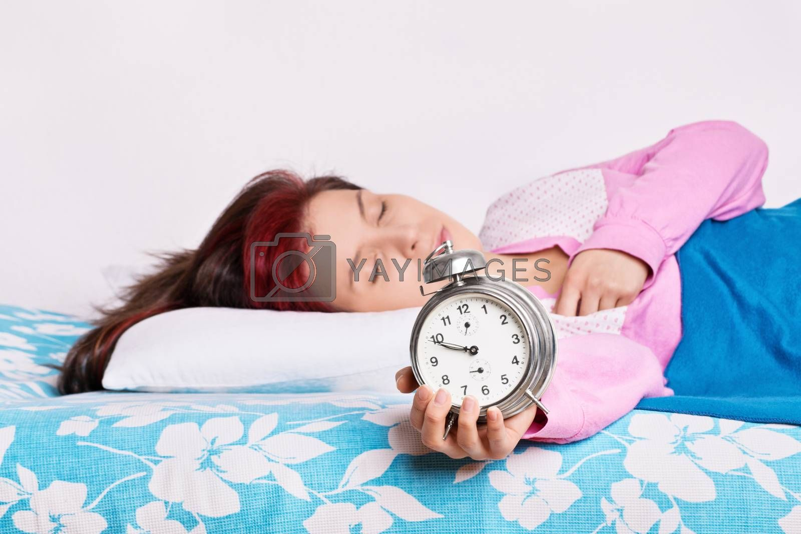 Young woman fallen asleep with alarm clock in hand by Mendelex