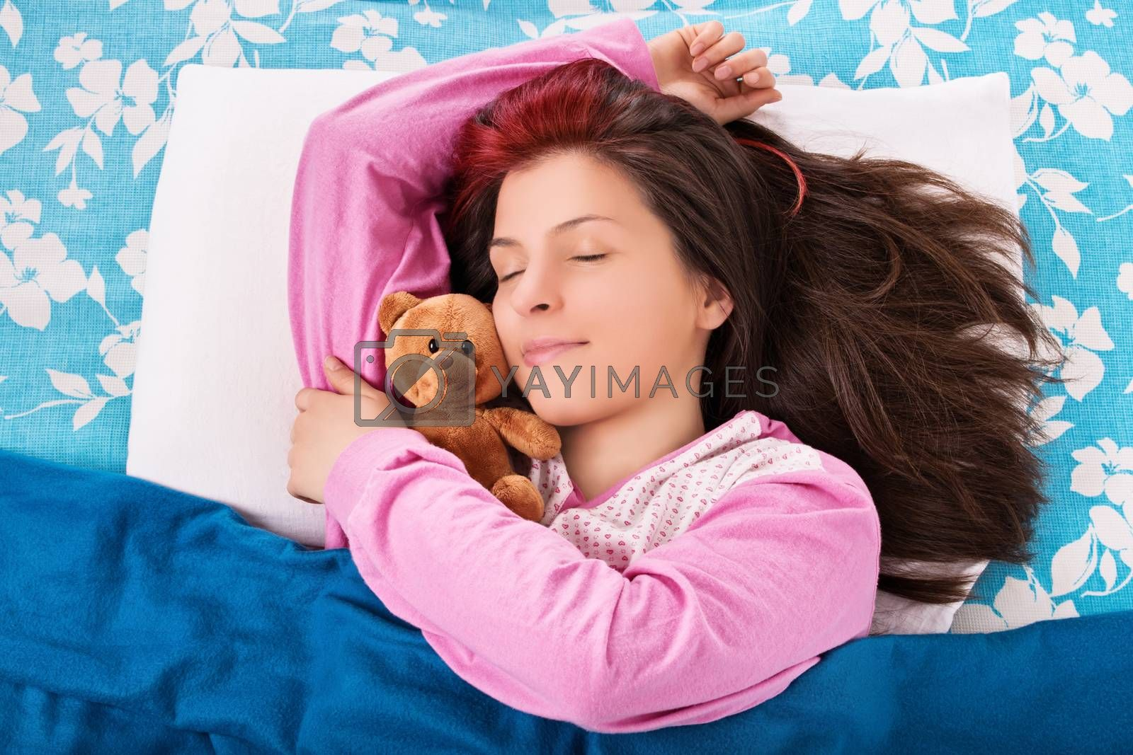 Young woman sleeping and hugging her teddy bear by Mendelex