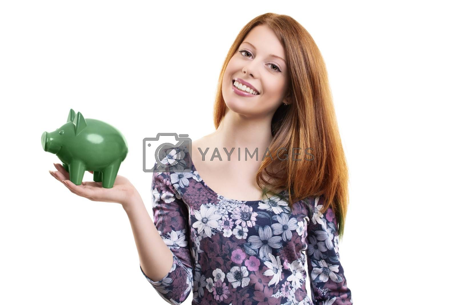 Beautiful young woman holding a green piggy bank by Mendelex