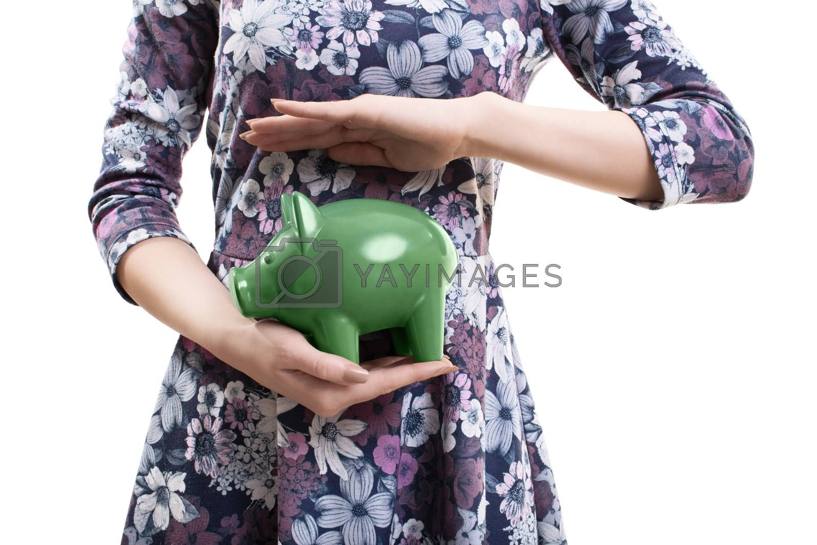 Close up of a young woman holding a piggy bank by Mendelex