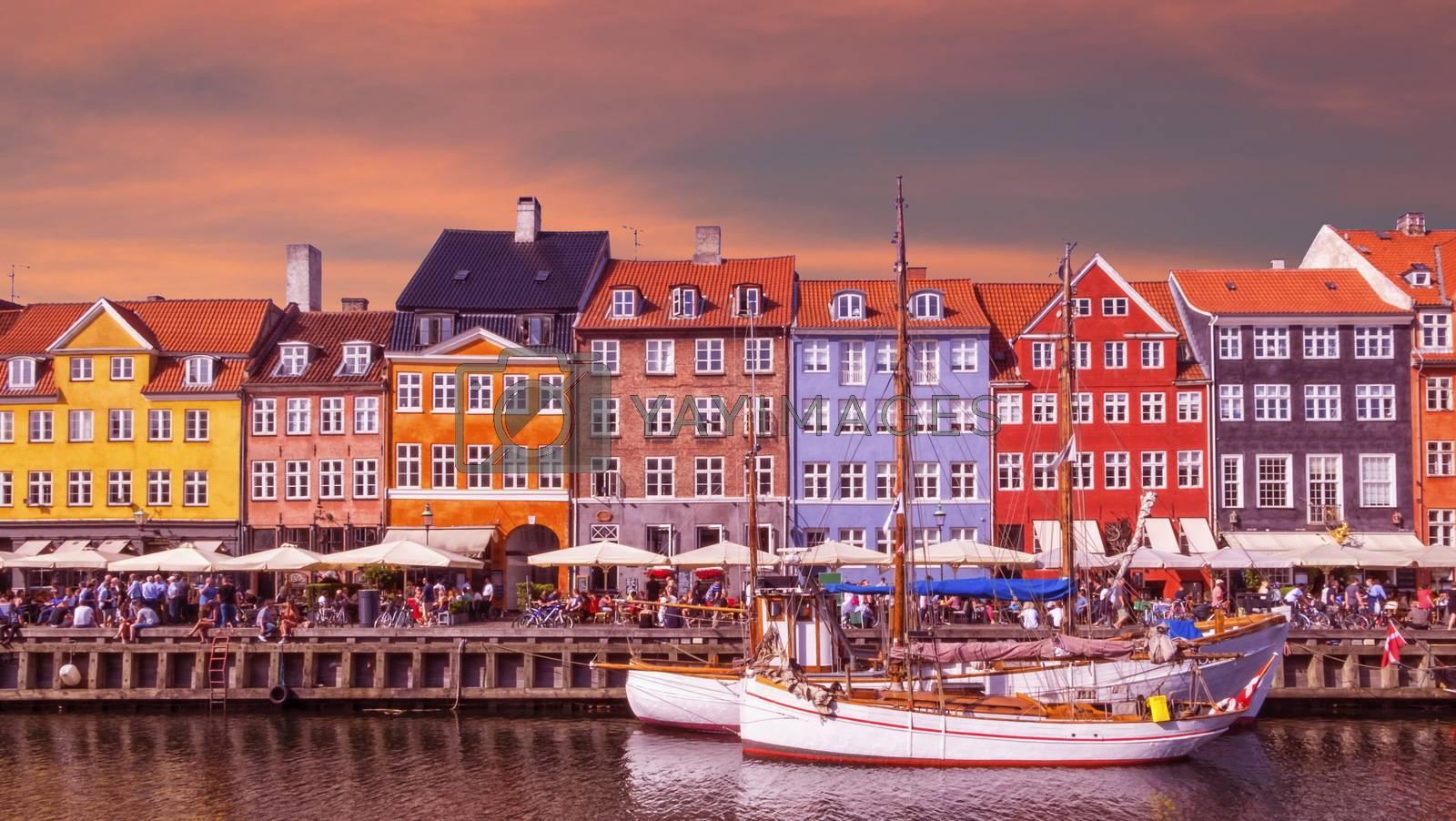 Scenic summer view of color buildings and boats of Nyhavn in Copenhagen, Denmark