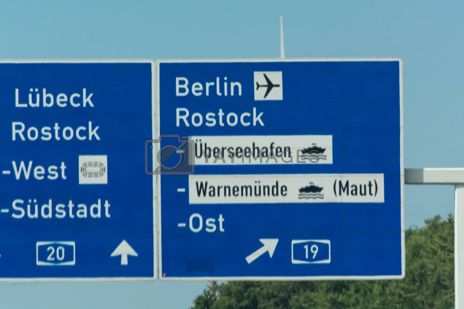 Autobahn sign in Germany Caption on German - city names Berlin,Berlin Airport, Rostock, Lübeck