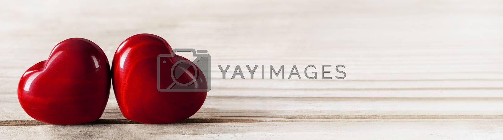 Two red wooden hearts symbol of love on wooden background, Saint Valentine Day celebration, copy space for text