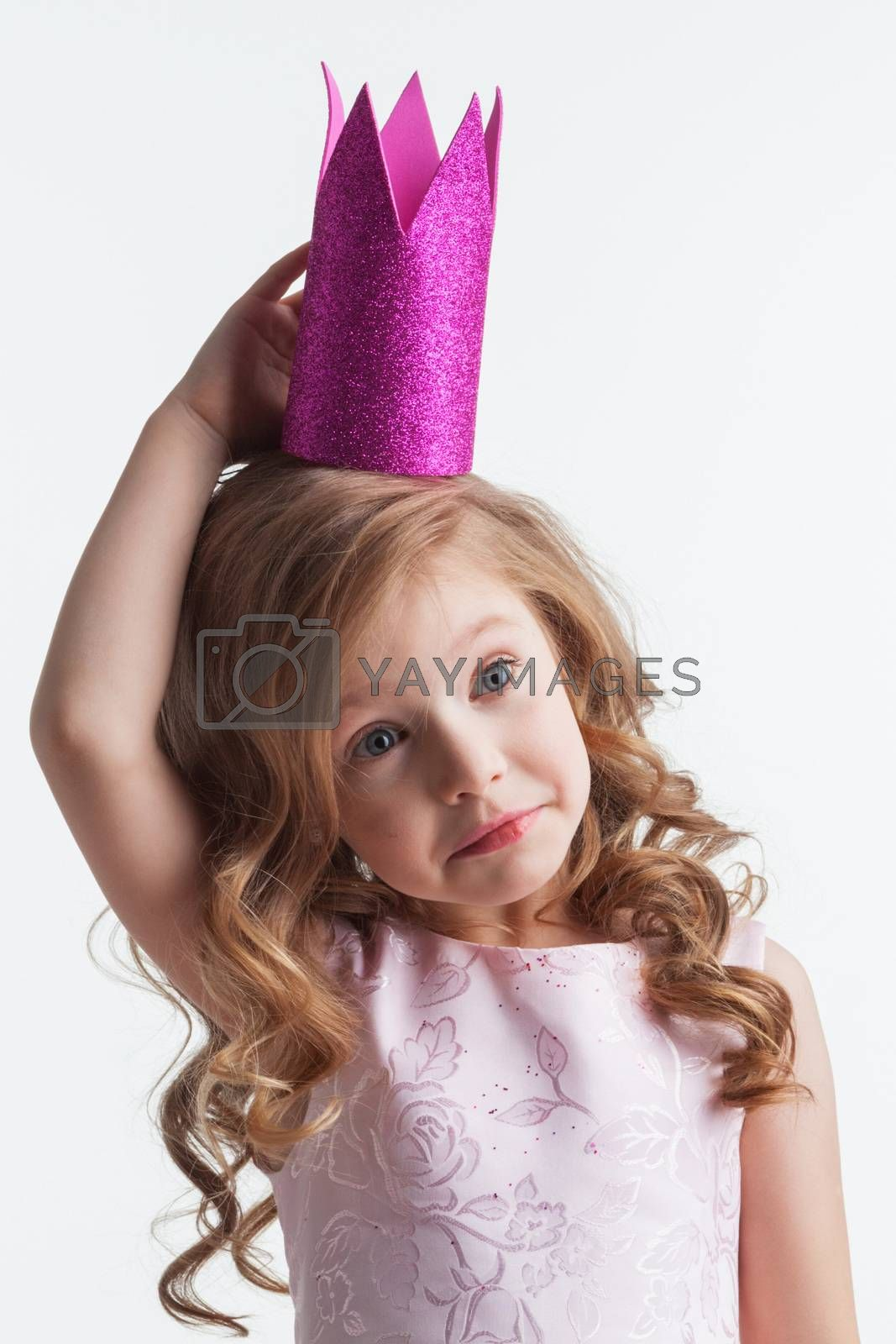 Little princess girl in pink dress and crown , studio isolated on white background