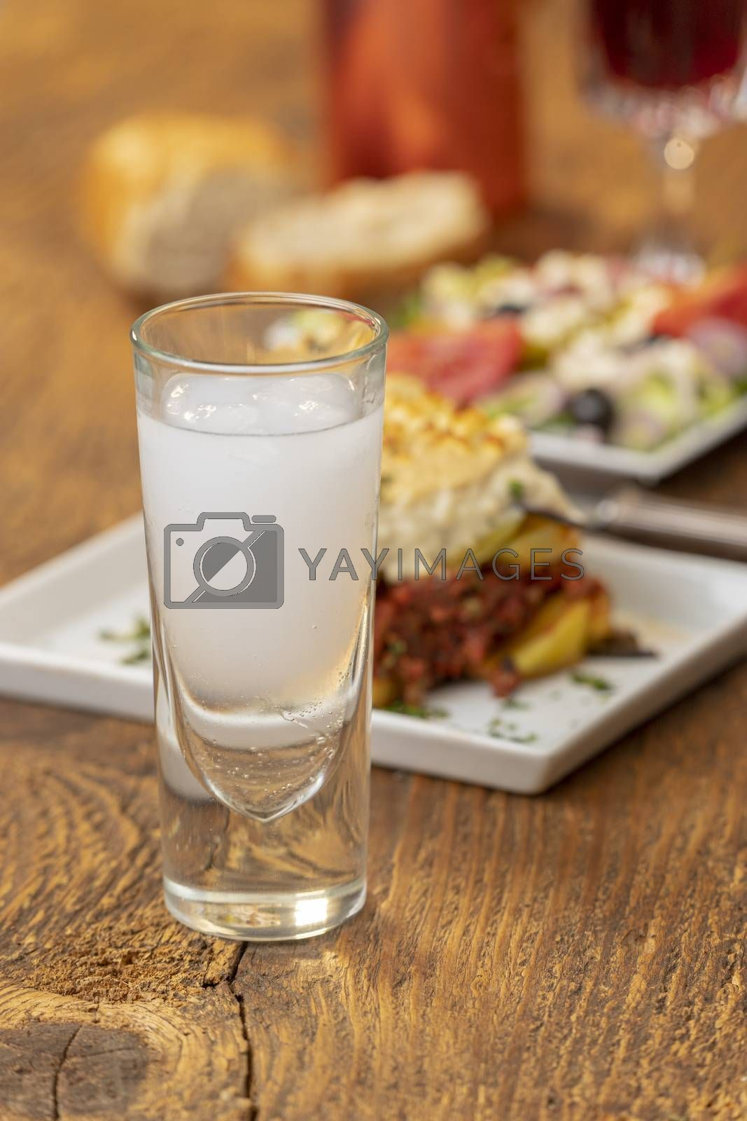 greek ouzo with moussaka on wood