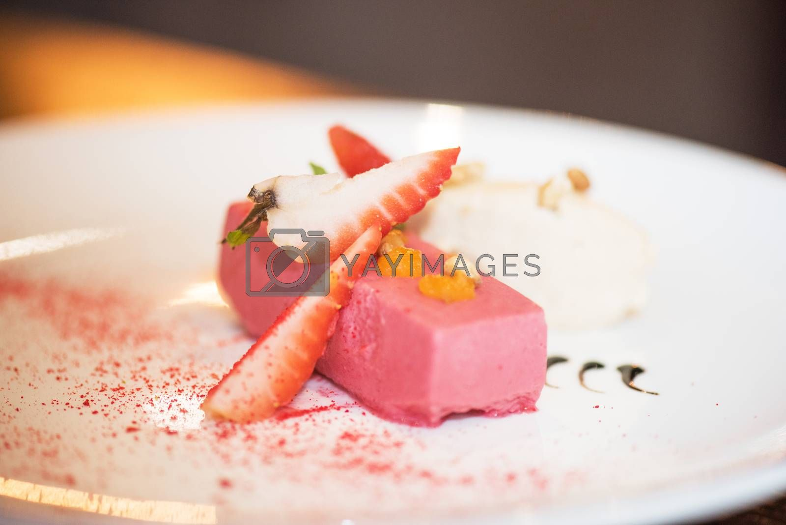 Fruit ice cream decorated with strawberries