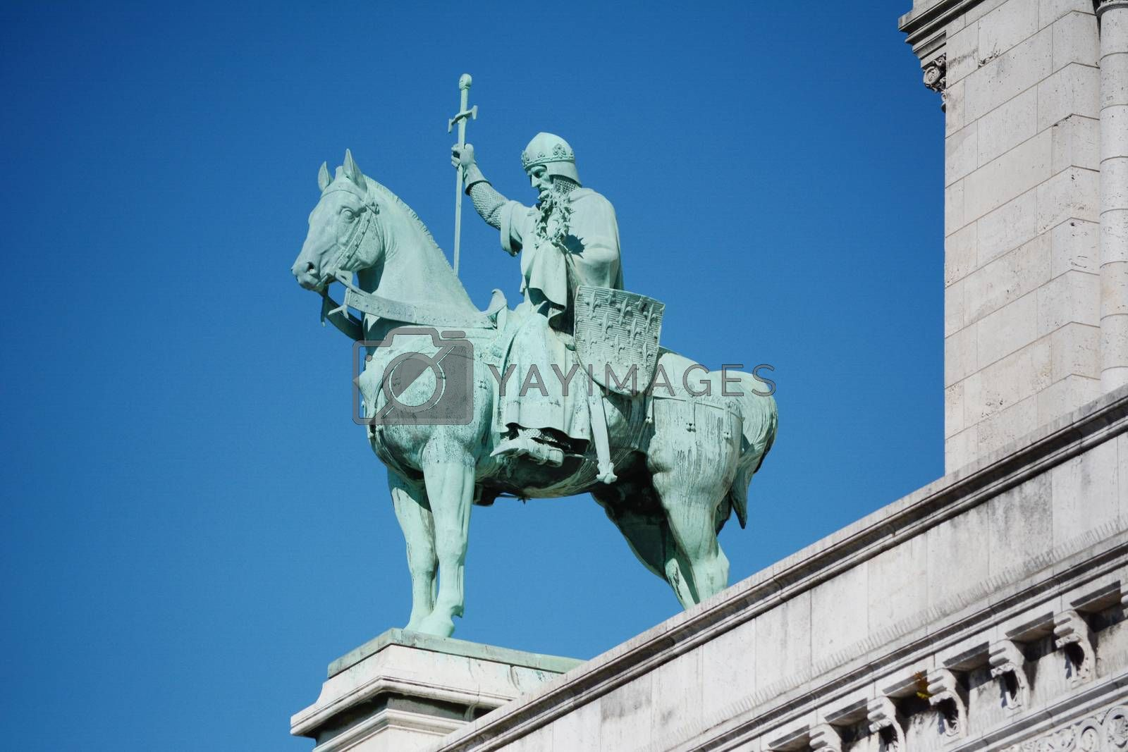 Bronze equestrian statue of King Saint Louis IX on the exterior of the Sacre Coeur basilica in Paris, France