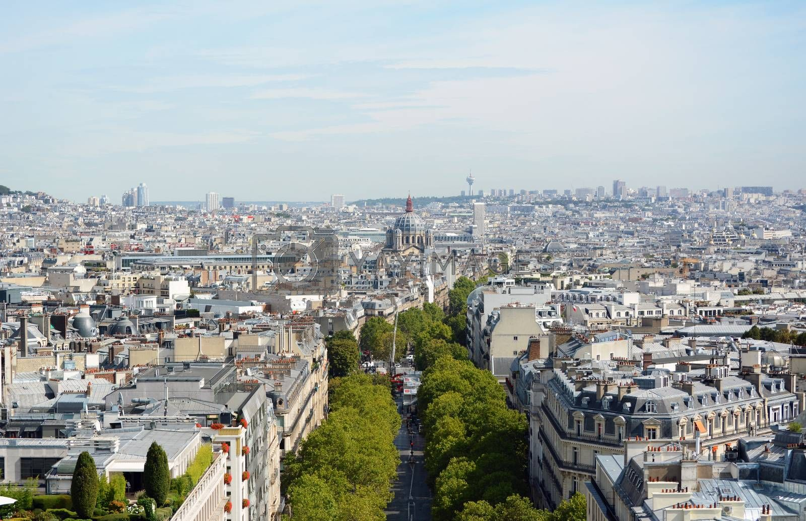 View down Avenue de Friedland from top of Arc de Triomphe, towards Saint-Augustin church. The Hertzienne communications tower stands 141 metres high on the outskirts of the city.