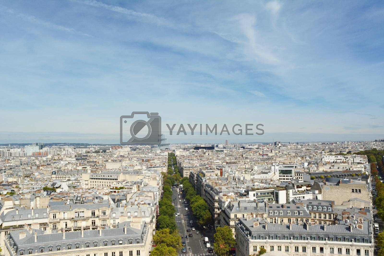 Paris cityscape from the top of the Arc de Triomphe, looking north along Avenue de Wagram. In the distance, the modern Tribunal de Paris building stands above the city.