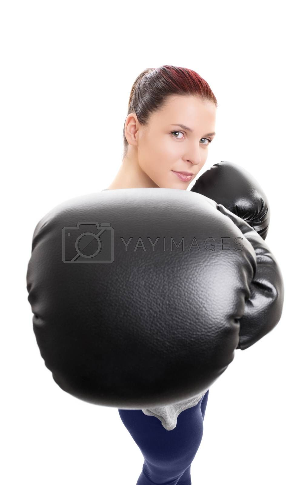 Young woman with boxing gloves punching the camera by Mendelex