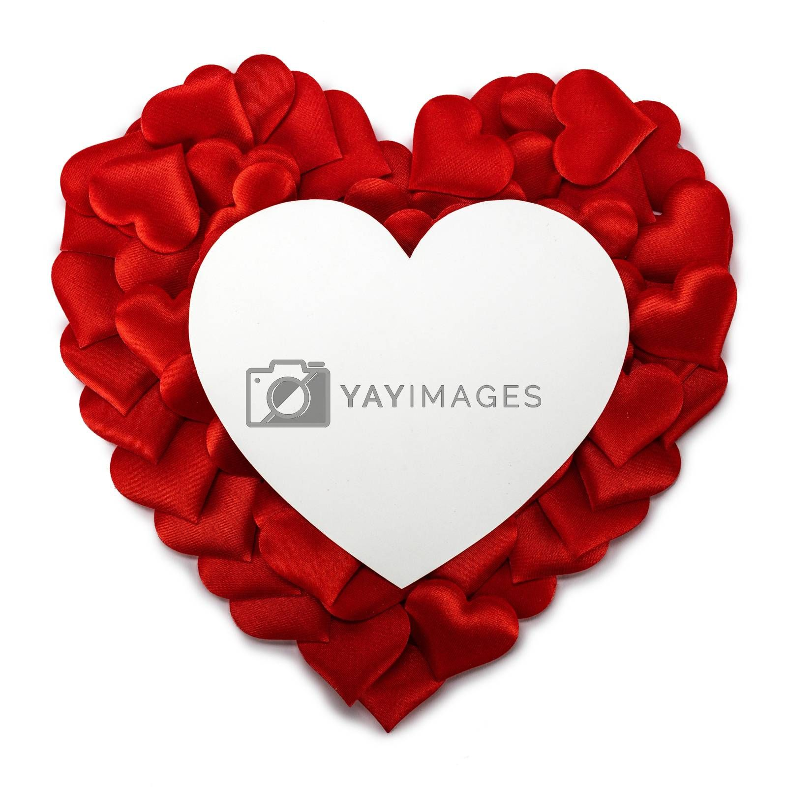 Valentine's day many red silk hearts and heart shaped card isolated on white background, love concept