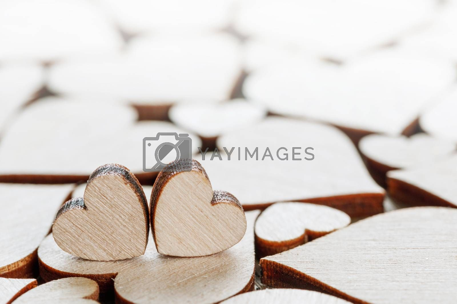 Many wooden colorless hearts background