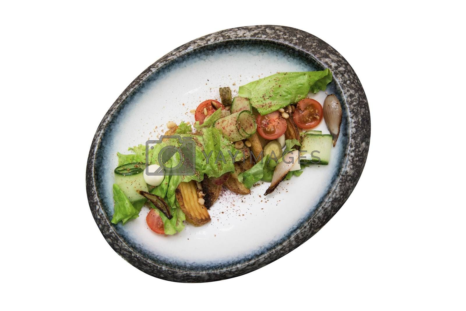 Salad with fried potato lettuce pickled cucumbers and tomatoes on decorate plate isolated on white background