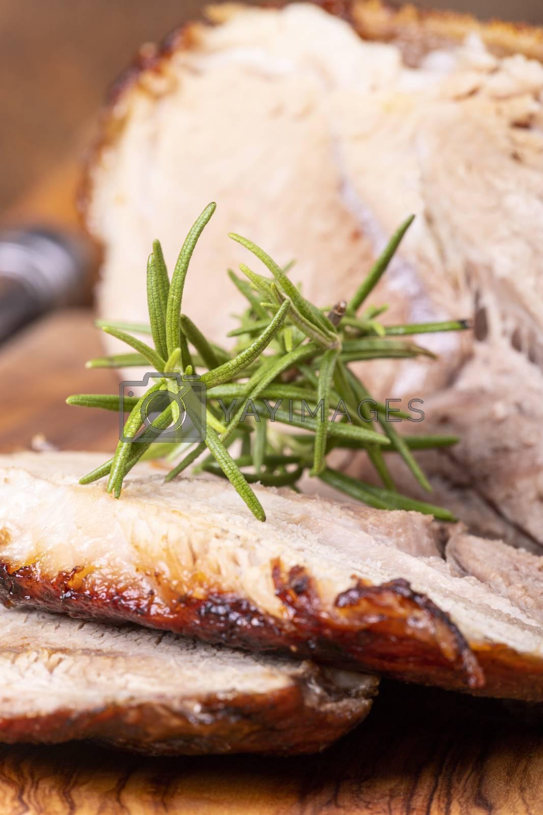 sliced bavarian roasted pork on wood