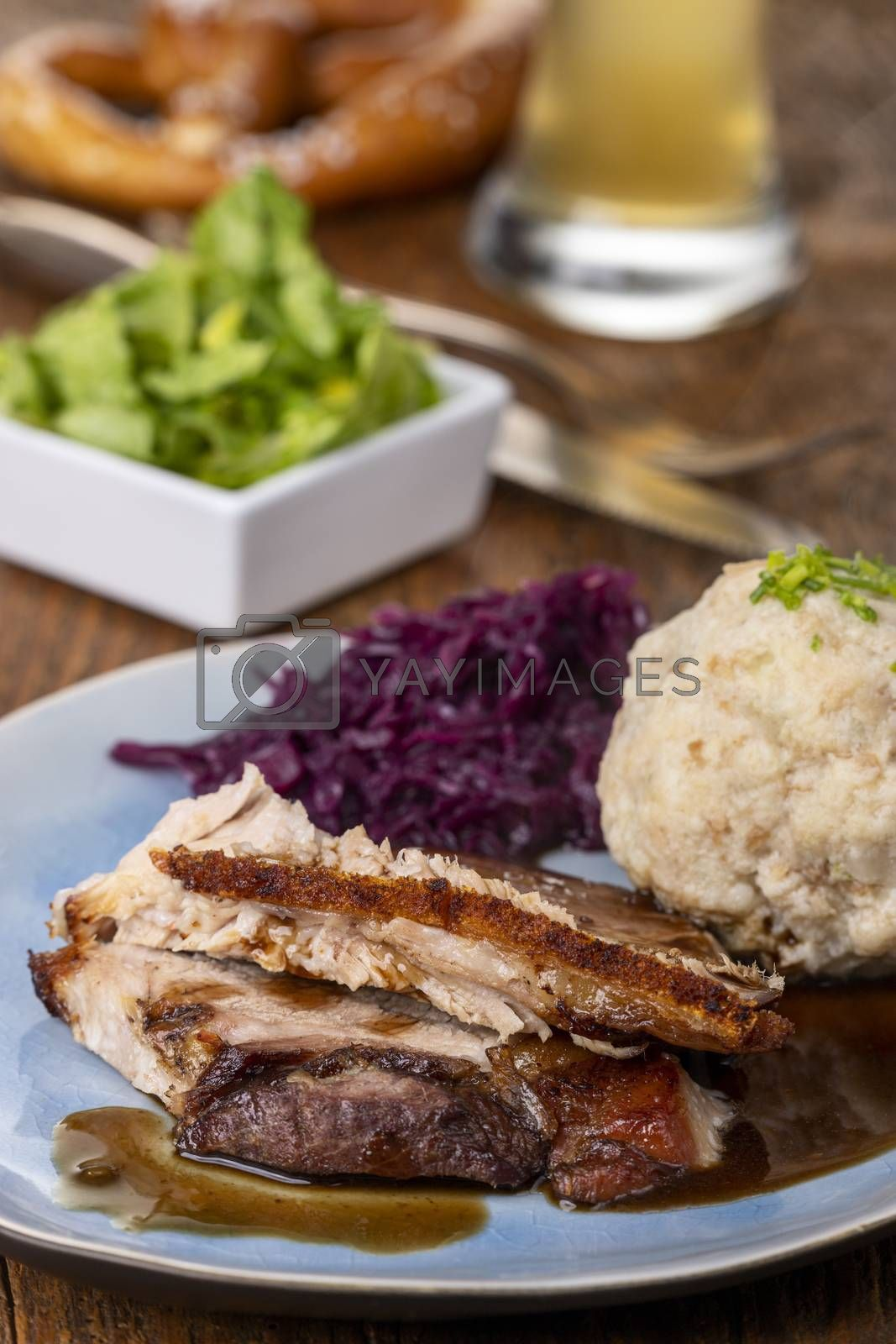 sliced bavarian roasted pork with dumpling