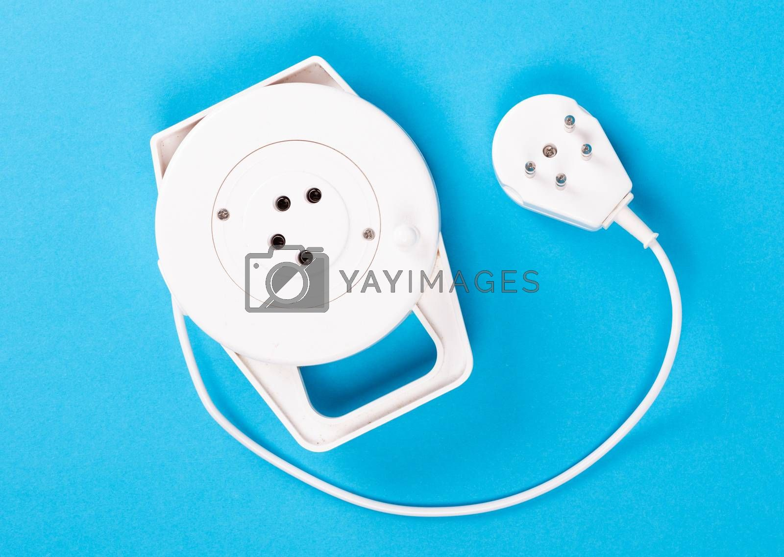Retractable phone cord isolated on blue background