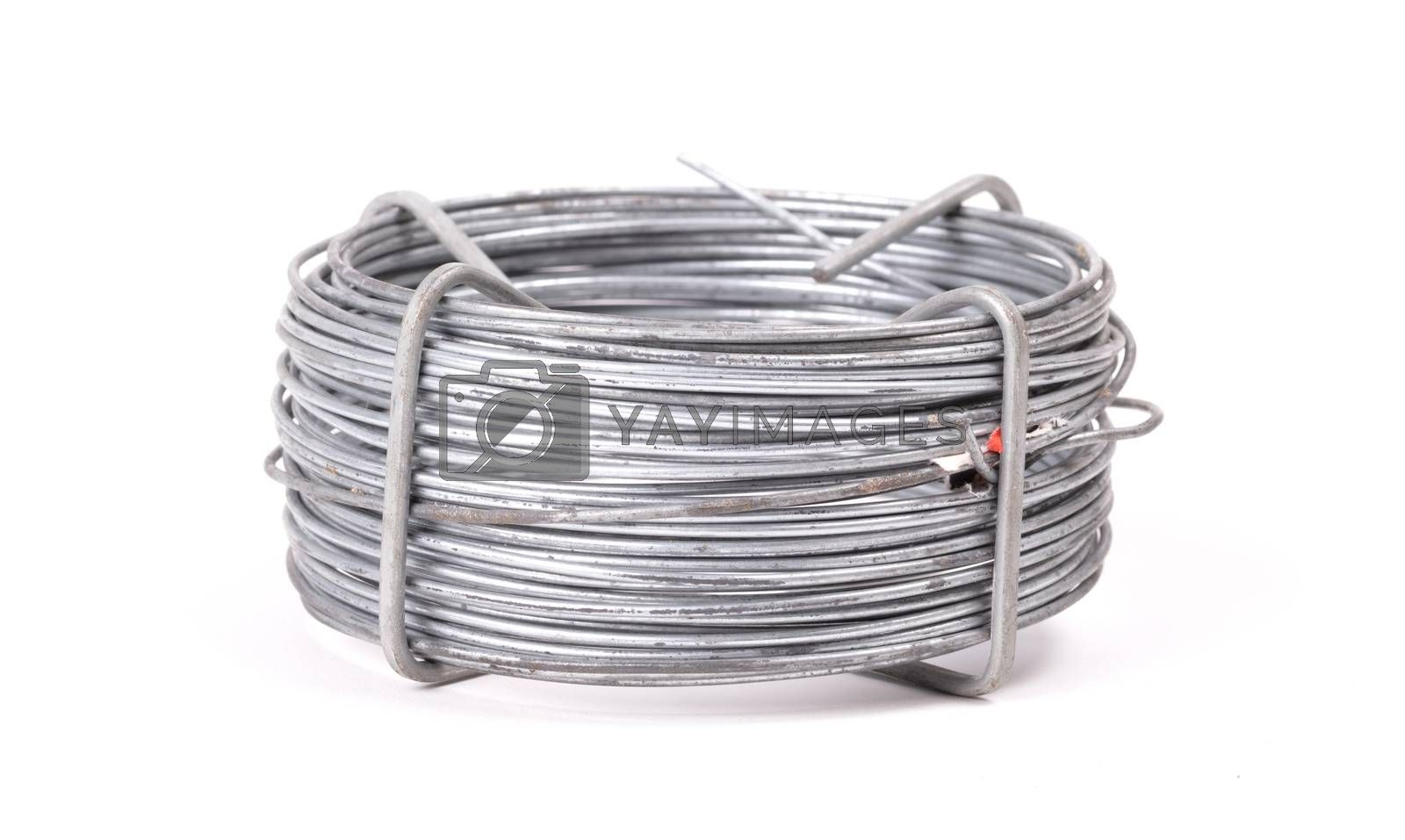 Roll of metal wire, vintage, isolated on white