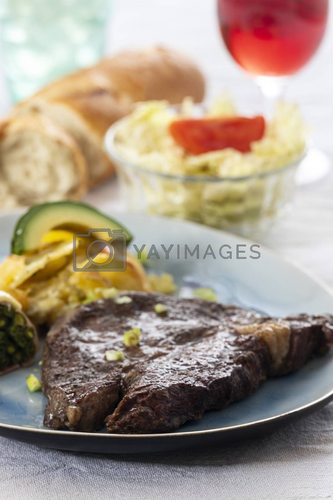 grilled steak with potato gratin