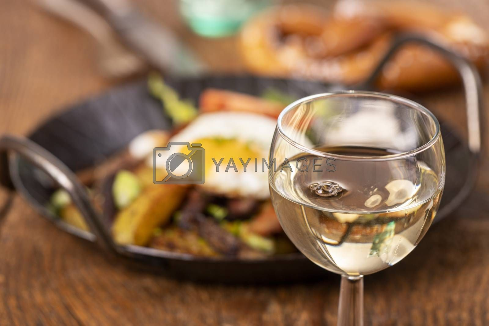 wine and tyrolean potato groestl in a pan  by bernjuer