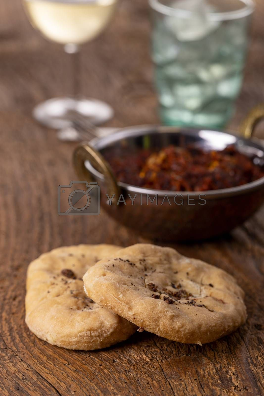 indian naan bread on wood  by bernjuer