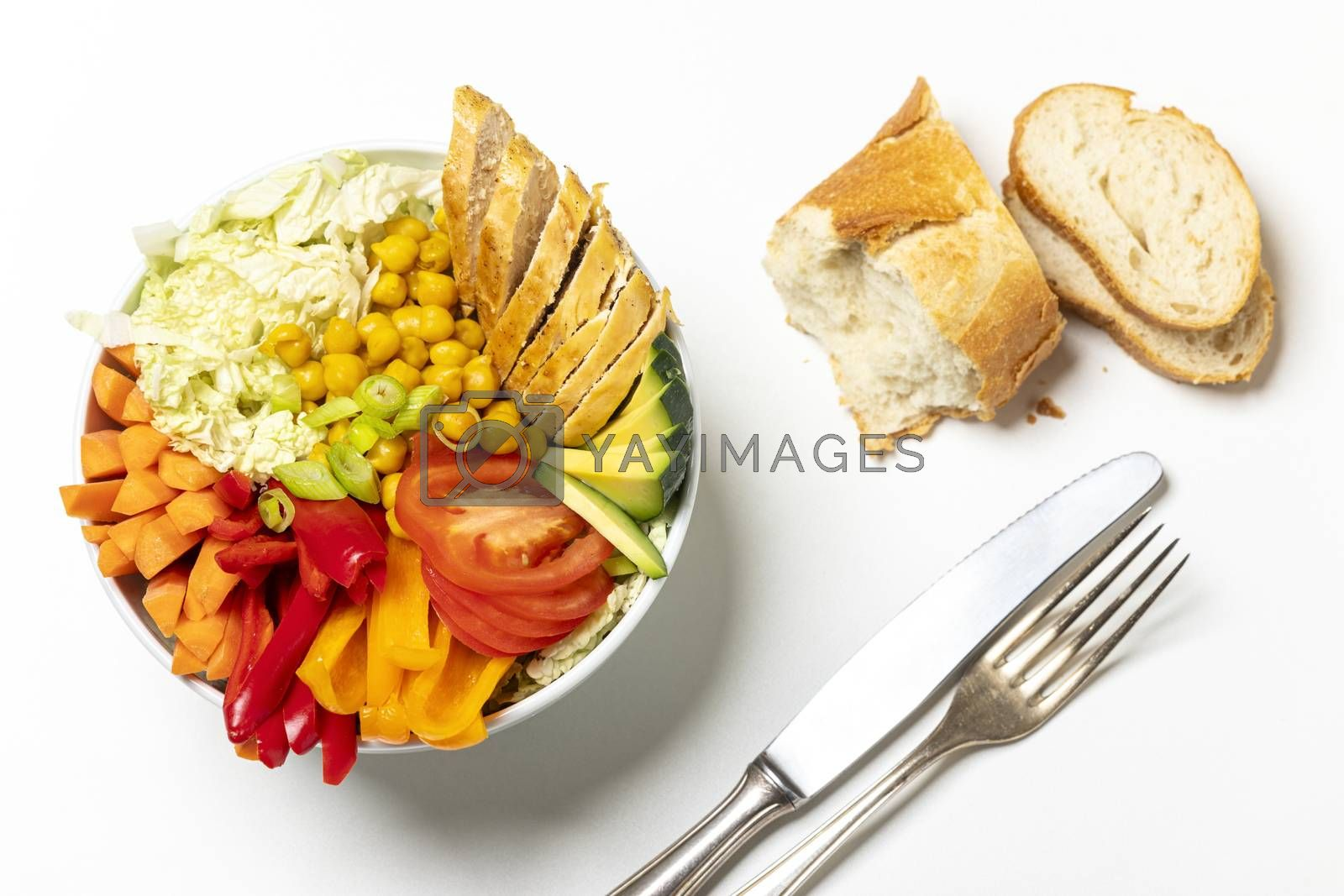buddha bowl with chicken on wood  by bernjuer