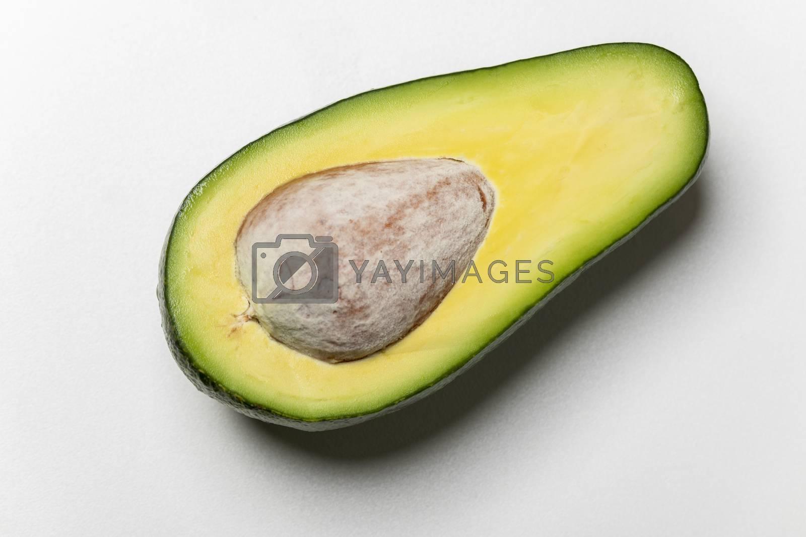 sliced avocado on white background  by bernjuer