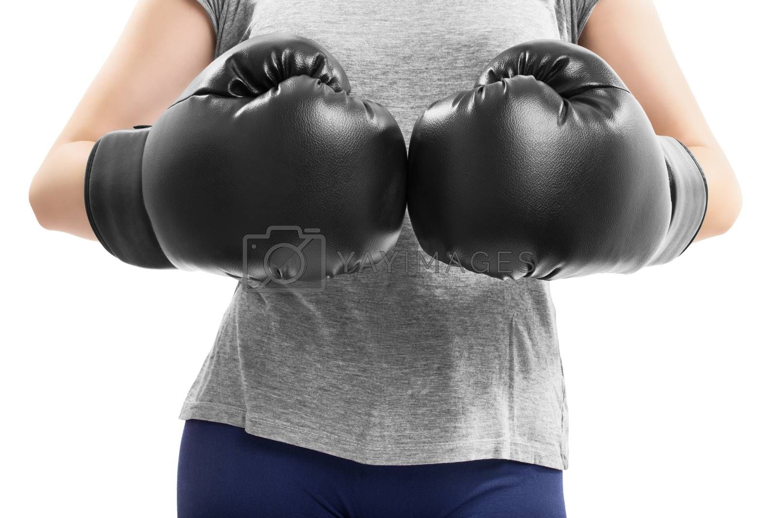 Close up of fit girl bumping fists in boxing gloves by Mendelex