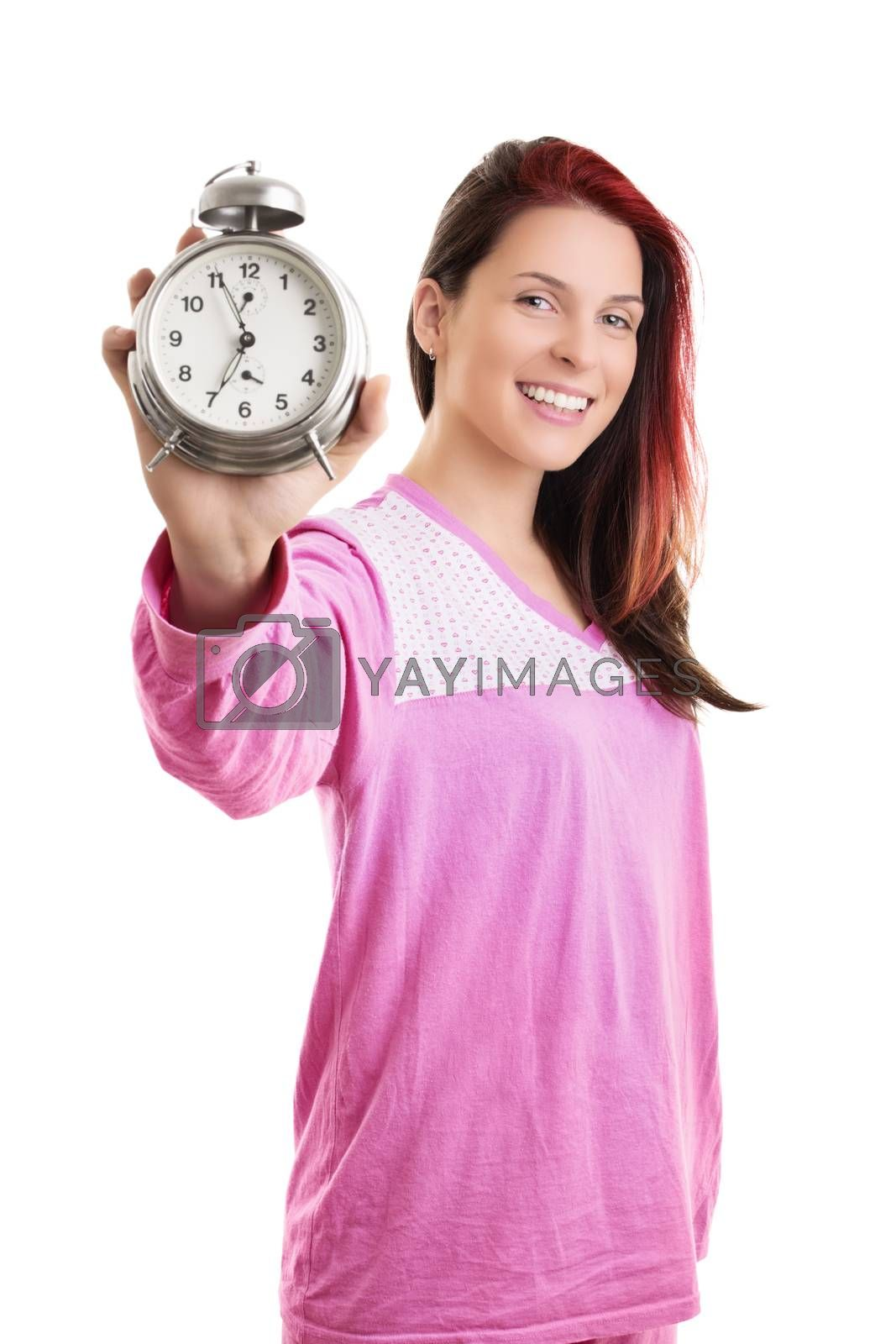 Young woman in pajamas holding alarm clock and smiling by Mendelex