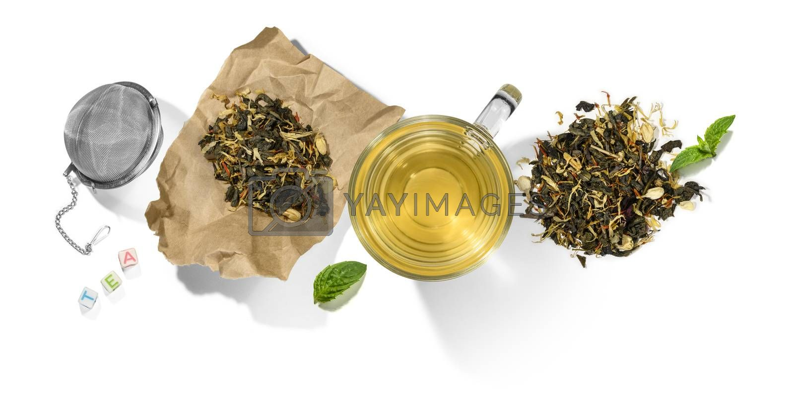 Green tea with aromatic additives and accessories. Top view on white background.