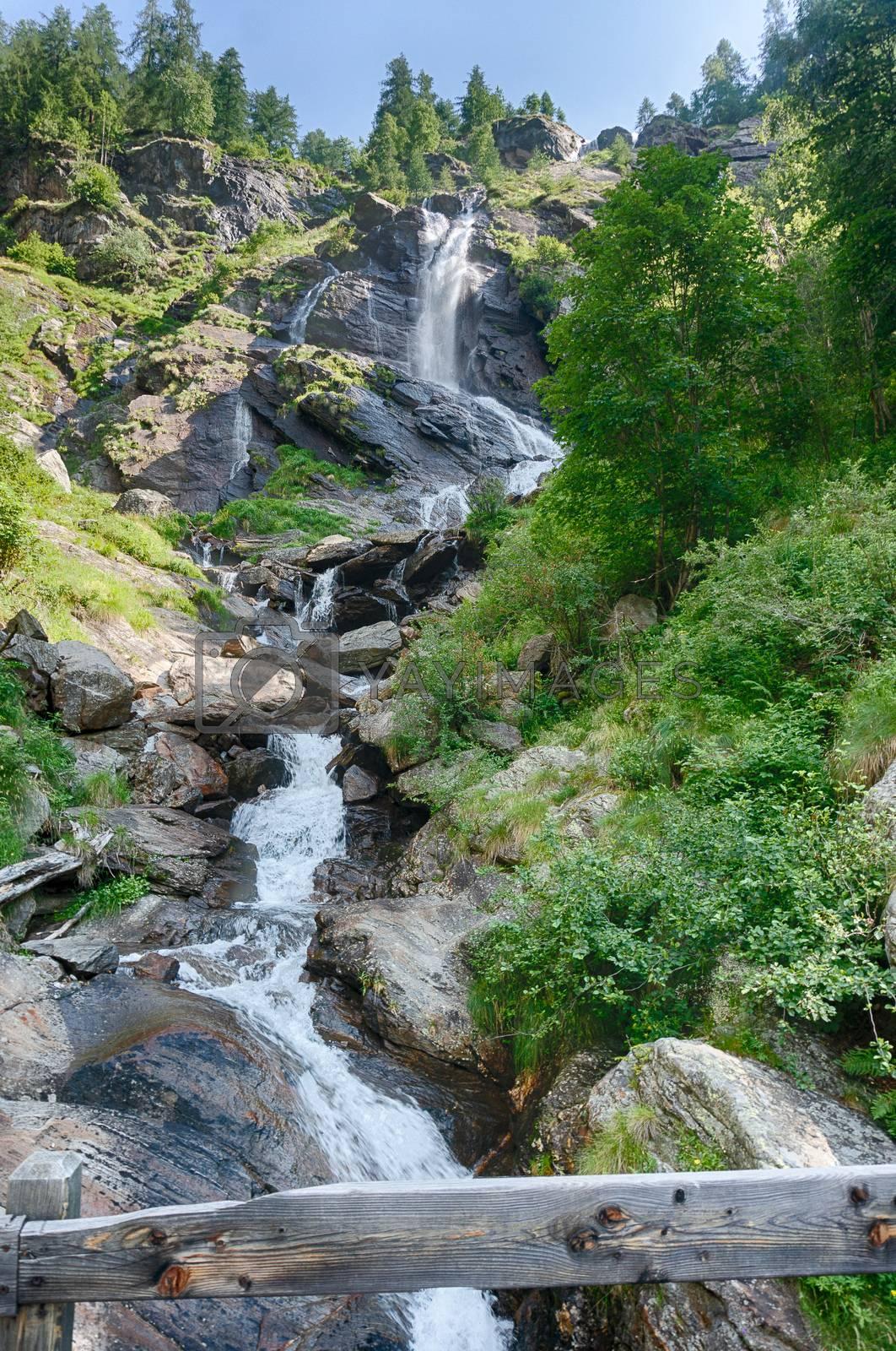 Waterfall in Italian alps travel