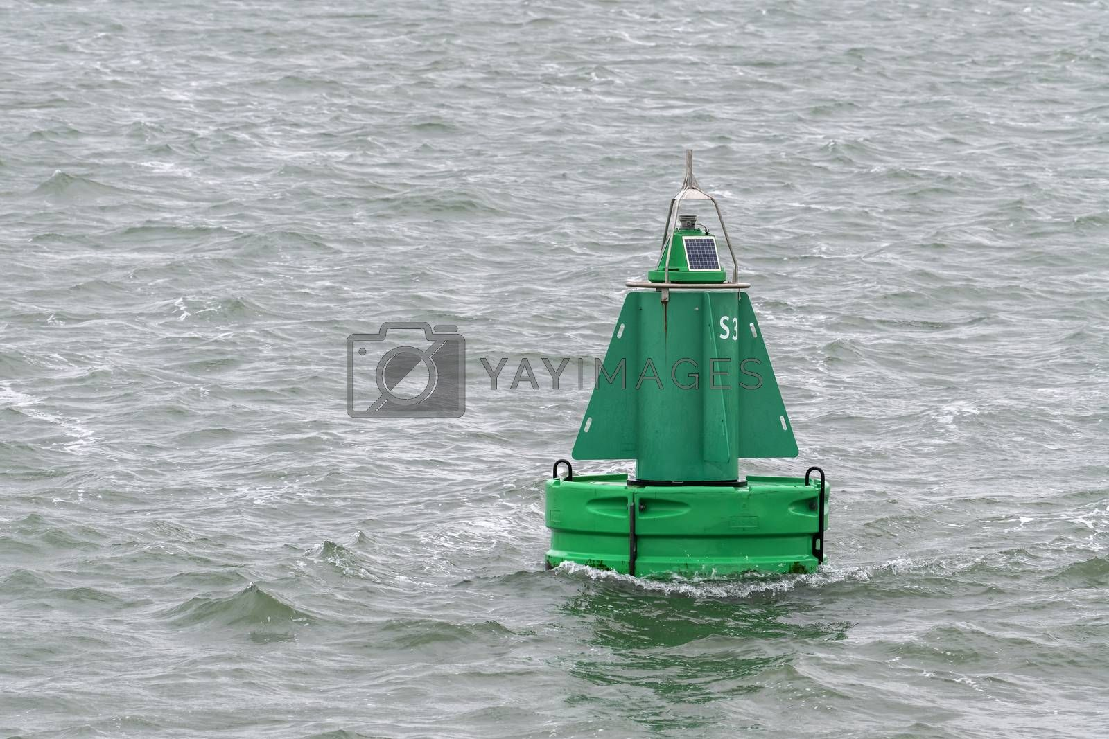 Green buoy as a marker for shipping   by Tofotografie