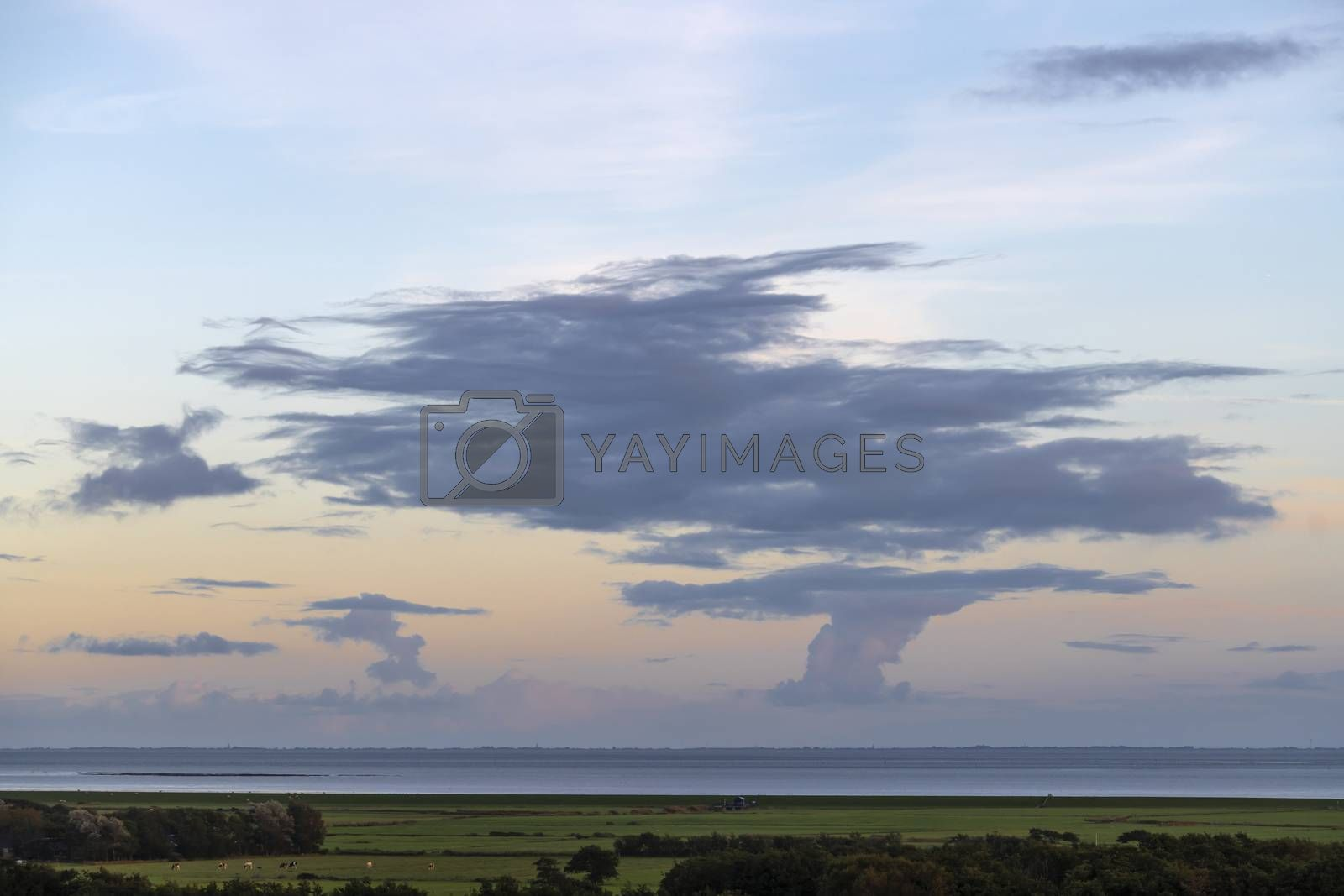 Impressive skies over Friesland as seen from the island of Tersc by Tofotografie