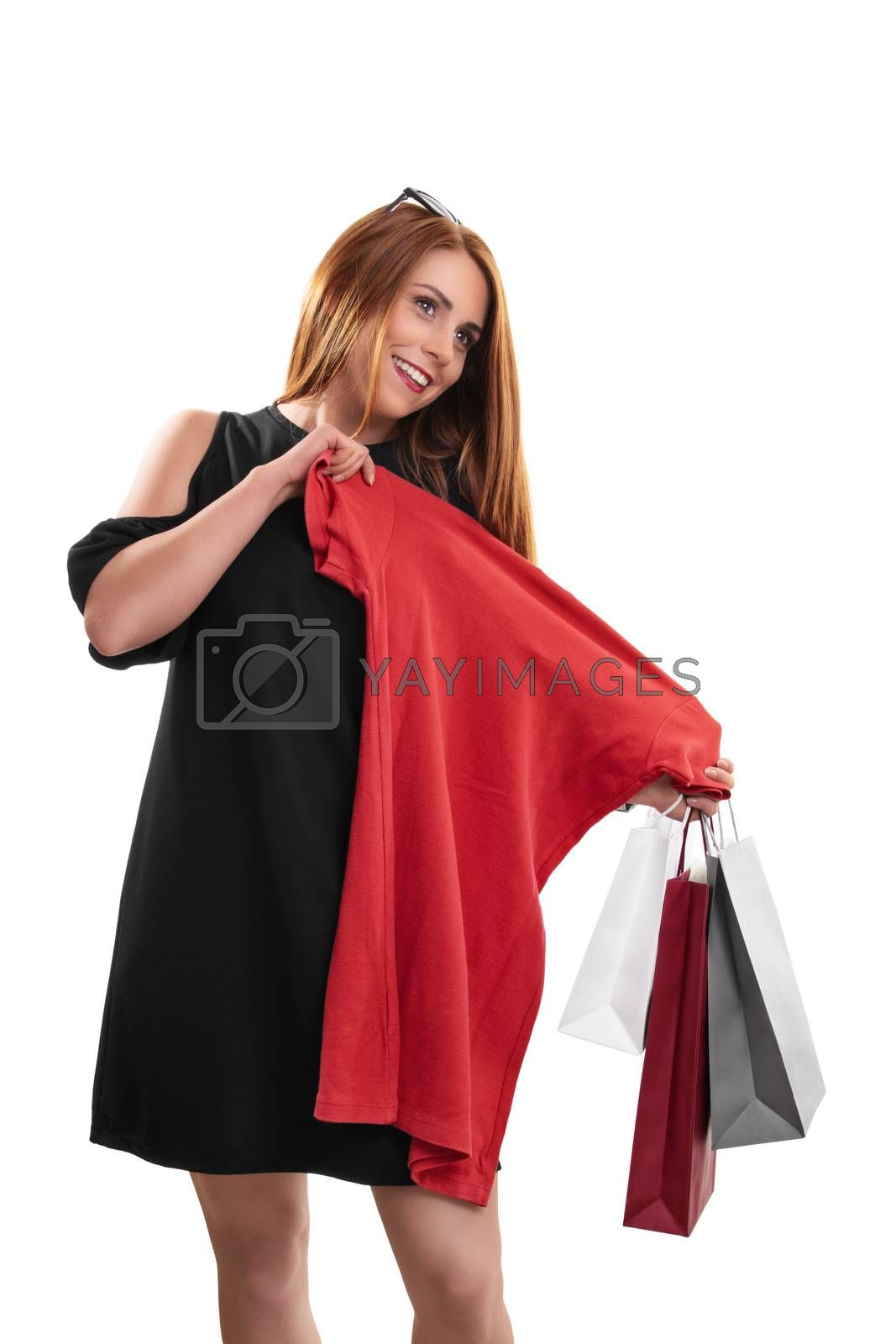 Beautiful smiling woman happy with her shopping by Mendelex
