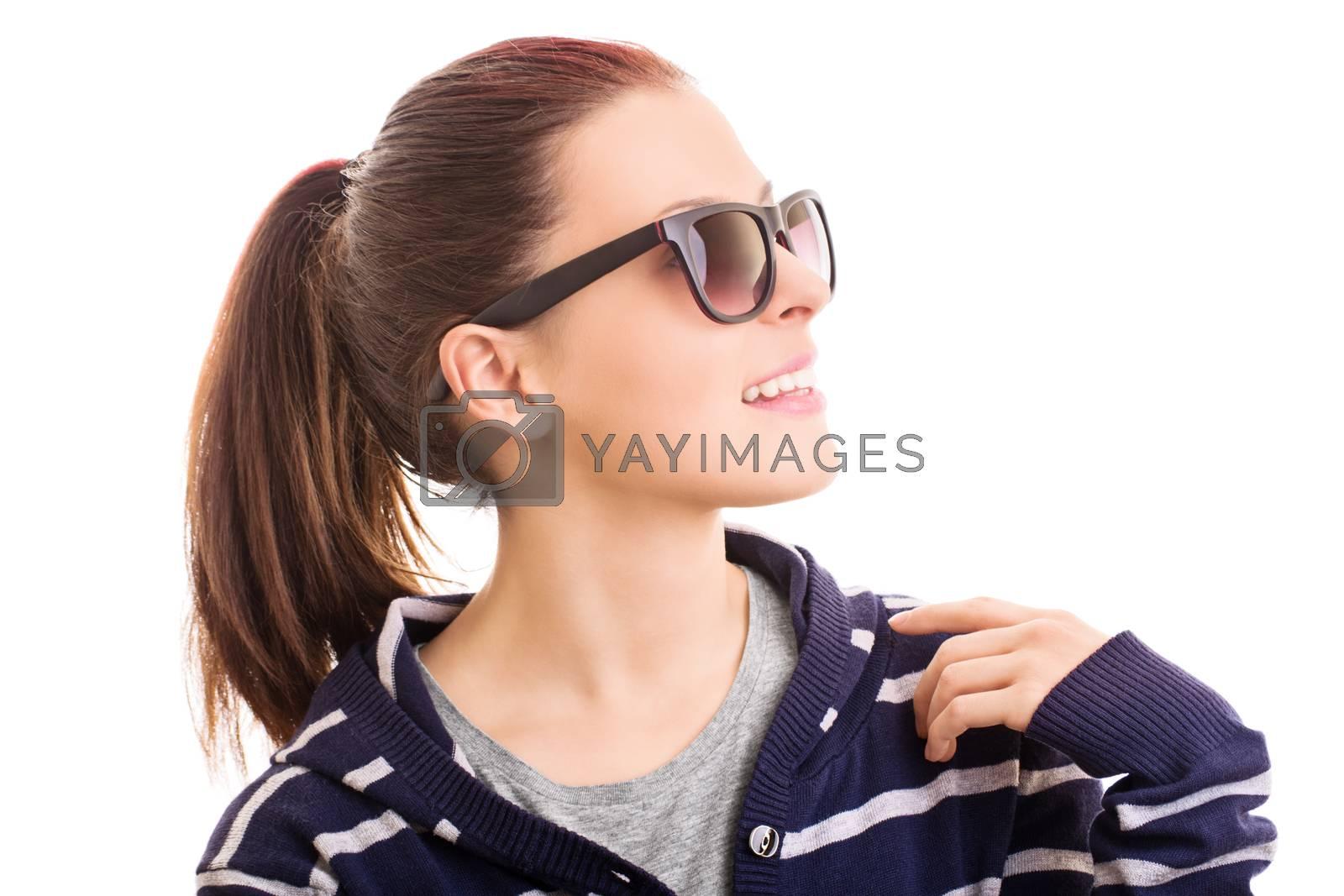 Profile shot of a smiling beautiful stylish girl with sunglasses, isolated on white background.
