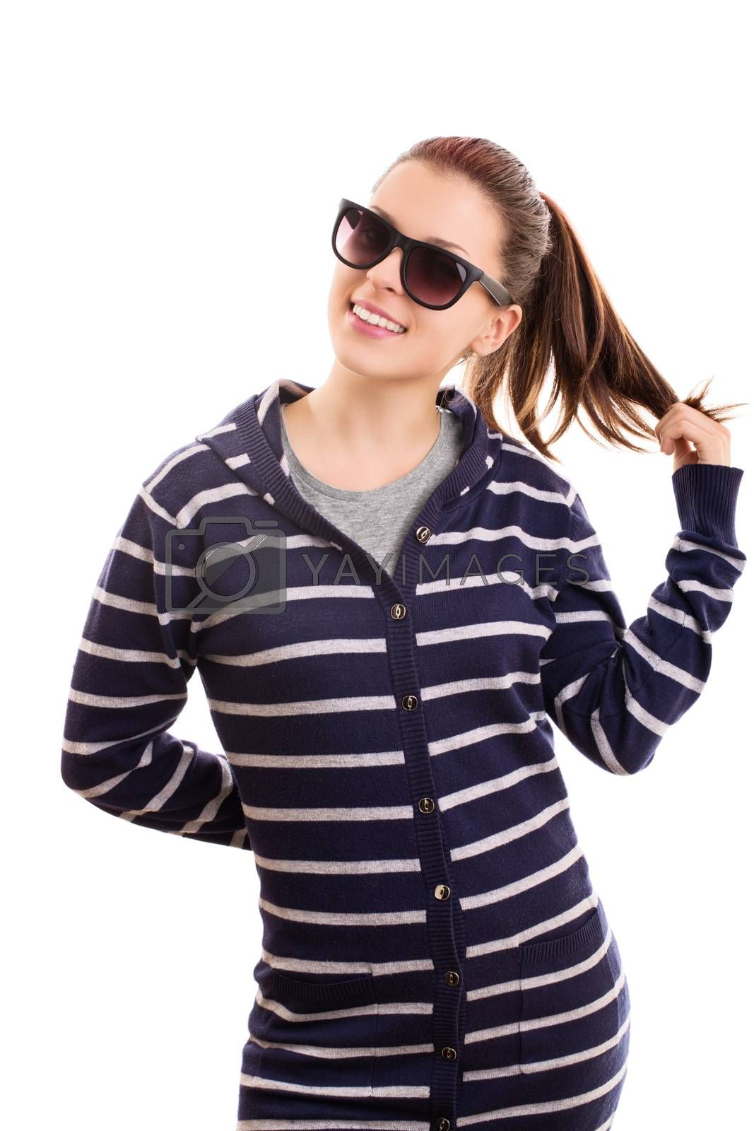 Portrait of a beautiful smiling casual girl with sunglasses playing with her hair, isolated on white background.