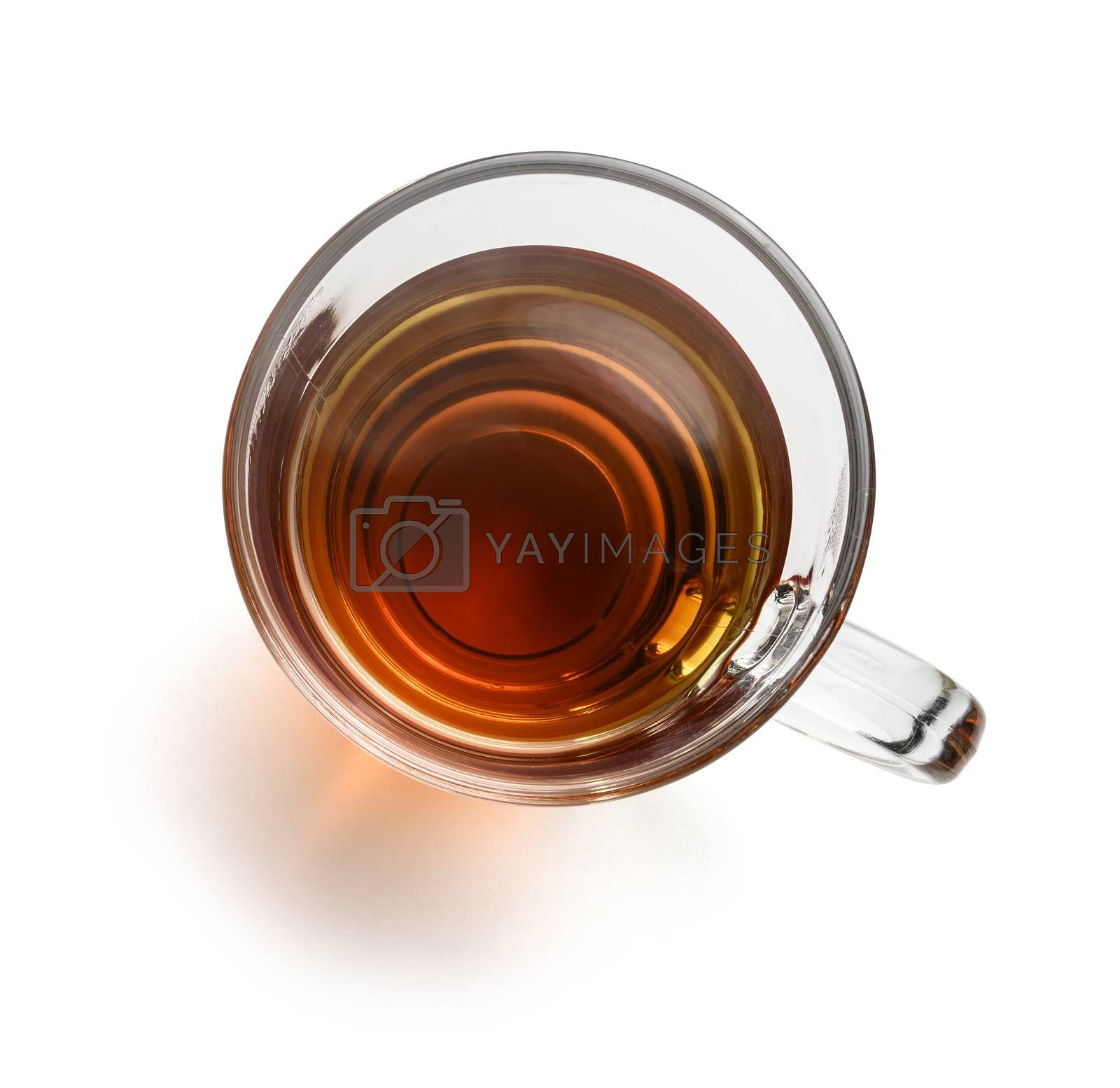 Tea in a glass mug on a white background. The view from the top.